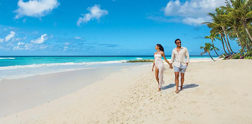 80b8bf9bcdcda Home TravelSandals® Resorts. couple on the beach